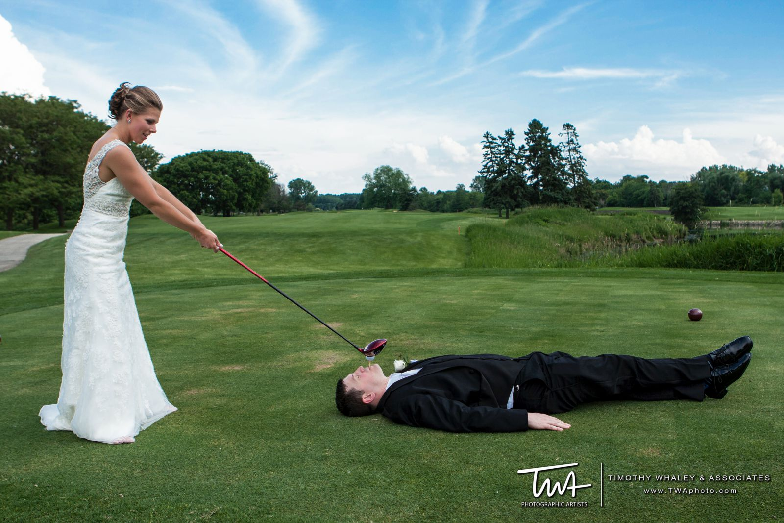 A bride pretends to tee off from the groom at Seven Bridges Golf Club in Woodridge
